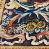 Conservation restauration d'un tapis tissé sous le règne de Louis XIV, entre 1670 et 1685, à la manufacture de la Savonnerie et destiné à garnir le plancher de la Grande Galerie du Louvre.